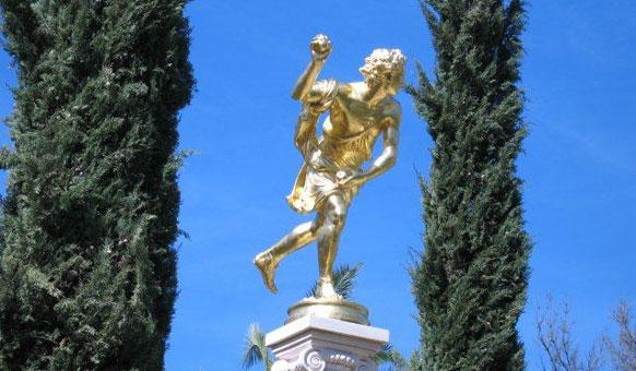 Gold-statue,-cypresses.jpg